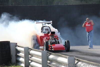 Red Altered Drag Car doing burnout
