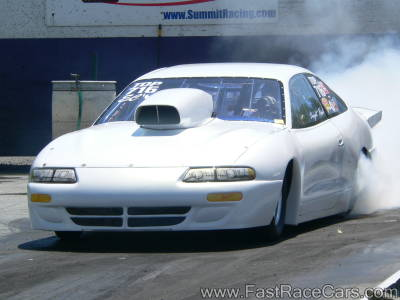 White Dodge Avenger Drag Car Doing Burnout