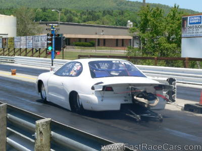 White Dodge Avenger Drag Car Launching