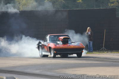 BLACK CORVETTE doing burnout