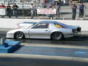 Silver Pontiac Firebird Staged