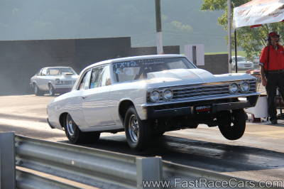 Solid White GTO Drag Car Poppin a Wheelie
