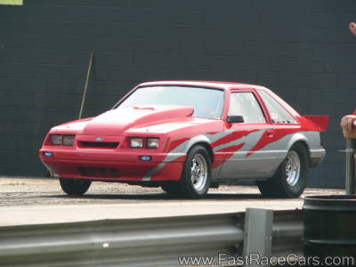 Red and Silver Mustang Drag Car
