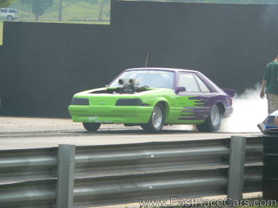 Green and Purple MUSTANG Drag Car Doing Burnout