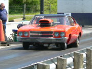 Orange Nova Drag Car With Black Vinyl Top