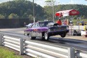Purple 1967 Nova Popping Big Wheelie